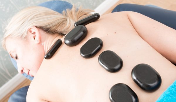 Hot stone massage soothes sore muscles
